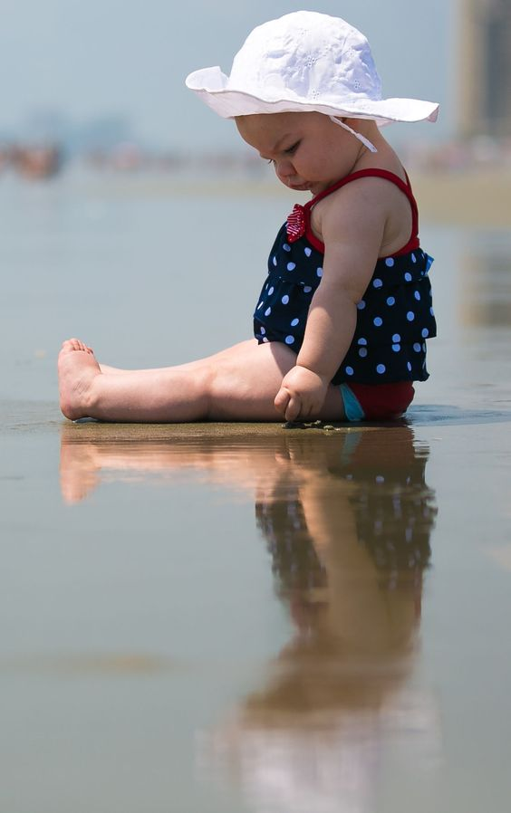 This past week was my daughter's first trip to the beach. We really limited her time there, but she really liked what time she did spend on the sand, she loved to mush the mud in her hands.   I had a lot of other shots from this set, but I thought this one was the most 'artistic'.