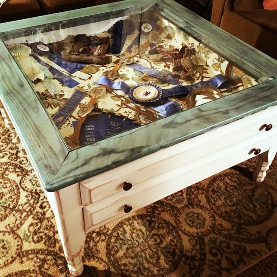 Display coffee table filled with horse show ribbons and buckles!