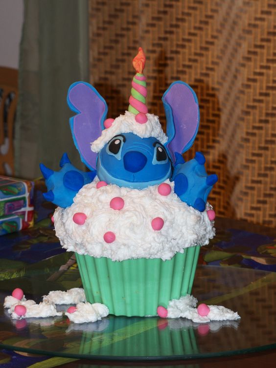 - I made this cake for my sister who is a huge Stitch fan.  The head is made of rice cereal.  The cupcake wrapper is candy melts, and the ears are gumpaste.  He was a lot of fun to work on. :)