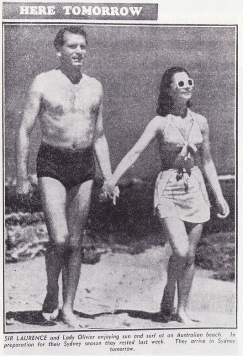Vivien and Larry walking on the beach in Australia, 1948.:
