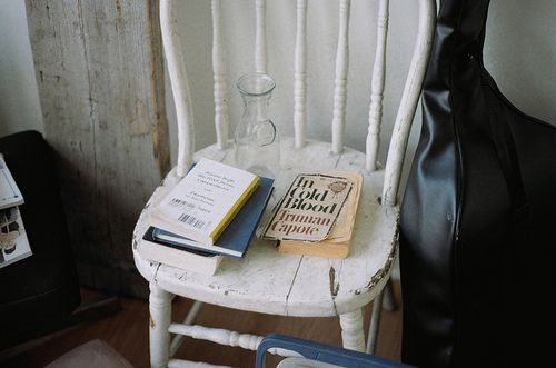 old white chair and books