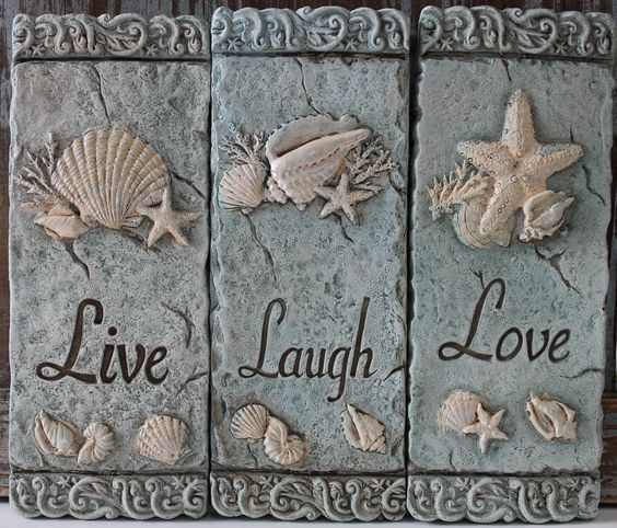 "Set of 3 sea green cement plaques ordained with raised white sea life carvings, intricate decorative borders, and engraved with the classic words Live, Laugh, and Love. Each plaque measures 8"" x 3"" - Coastal Beach Decor - California Seashell Company"