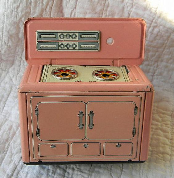 Vintage pink tin litho toy stove.