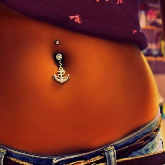 """Anchor belly button. My inspiration to get tan.  I could care less about the piercing. But this isnt """"carrot"""" color. This is like, """"sweet potato"""" color."""