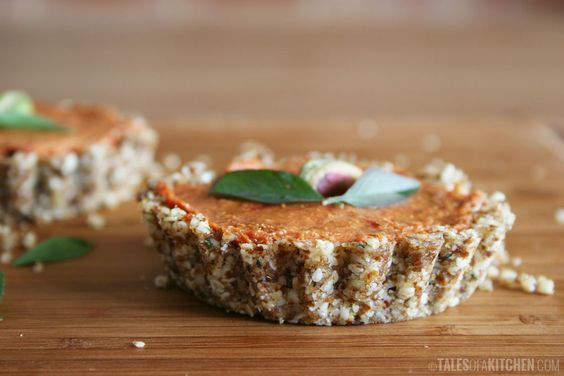Raw tiny tomato tarts filled with the most amazing sun dried tomato cream. Powerful flavors, zesty, creamy and nutty.
