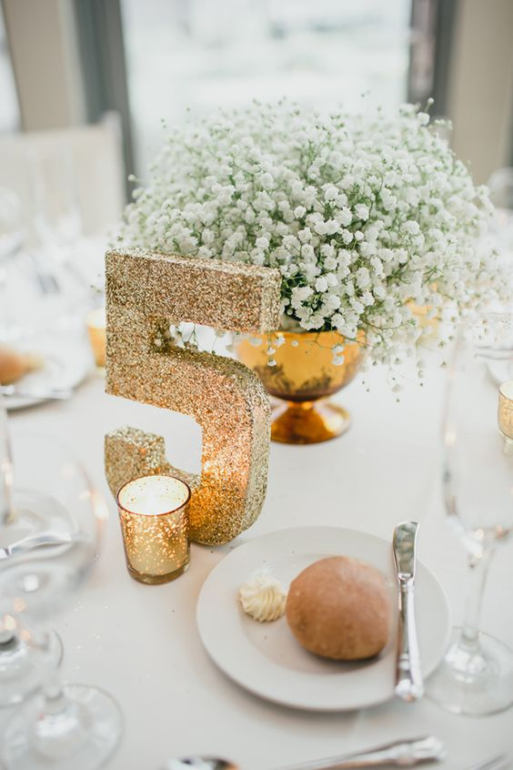 Gold centerpieces numbers and table on pinterest