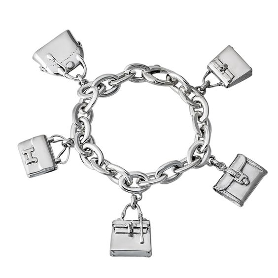 Hermes Sterling Silver Bag Charm Bracelet | From a unique collection of vintage charm bracelets at http://www.1stdibs.com/jewelry/bracelets/charm-bracelets/