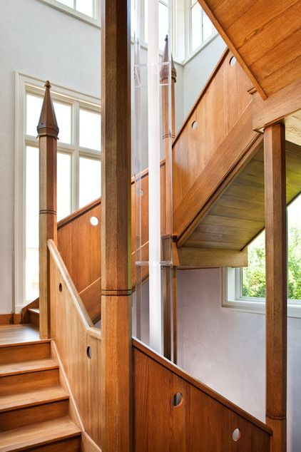 It's hard to tear your eyes away from this beautifully constructed stairwell, but once you do, you'll notice the custom tube light running through the center. If you have winding stairs as stunning as these, light them from top to bottom for a real showcase.