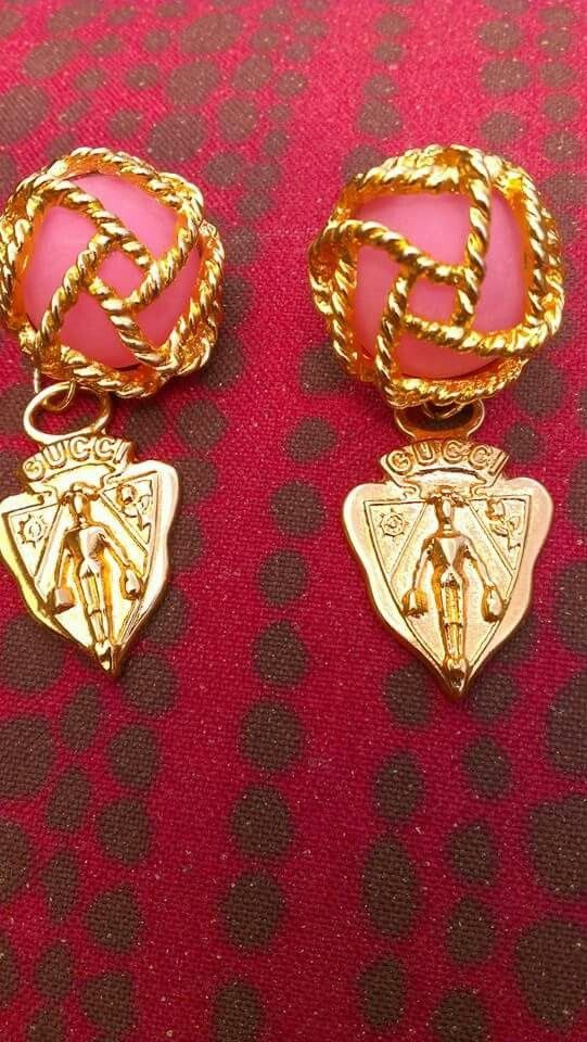 Gucci clip on earrings converted to pierced and I added some Gucci zipper pulls as charms. My favorite conversion so far.
