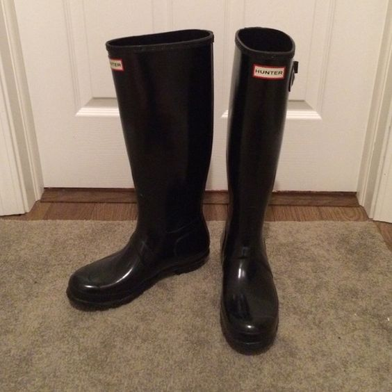 Tall Gloss Hunter Rain Boots Like-new, tall, black gloss Hunter rain boots. Bought at Nordstrom roughly a year ago and only worn a handful of times. Size in boots says  US 7M/8F, EU 39. Minor scuff marks that are barely noticeable. Boots come with original box and tissue paper. Hunter Boots Shoes Winter & Rain Boots