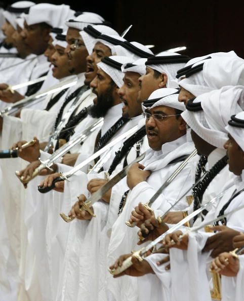 Saudis take part in the traditional Arda dance or War dance during the Janadriyah Festival of Heritage and Culture in the Saudi capital Riyadh late...