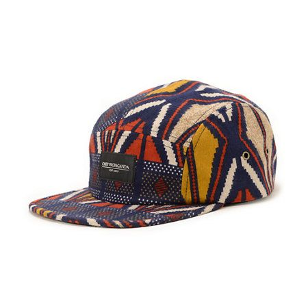 The Obey Nation navy 5 panel hat is comfortable camper hat with a crazy and unique all-over cotton print. Throw on the soft cotton Nation 5 panel hat with an all-over geo tribal print in multiple colorways with eyelets to keep your head cool and an adjust