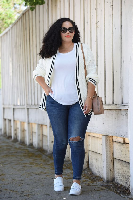 Tanesha Awasthi, also known as Girl With Curves, wearing a white tee, plus size skinny jeans, white sneakers and Chanel bag.: