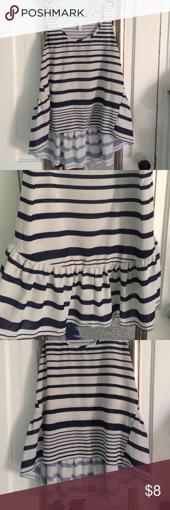 Striped Xhilaration Sleveless Blouse Cute Sleveless top with navy stripes. Has kinda of a ruching in the back as pictured. 100% Polyester size medium. Xhilaration Tops Blouses