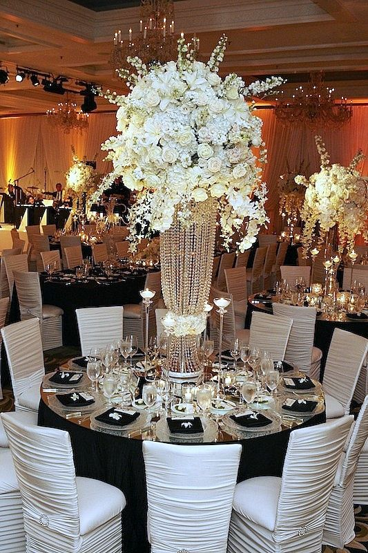 Black or white organza napkins, garland, and table overlays as well as napkin rings, coasters, and wine covers available at alwayselegant.com