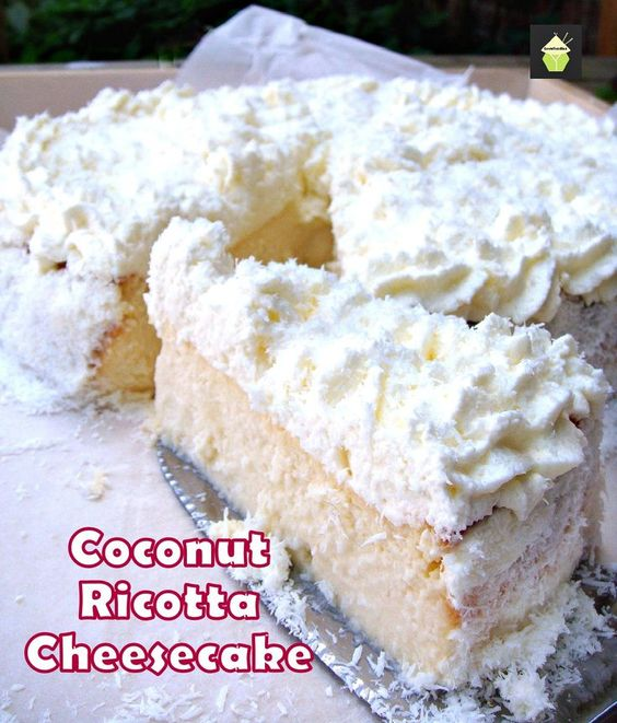 Coconut Ricotta Cheesecake. A wonderful fluffy, soft & creamy baked cheesecake, out of this world! #dessert #cheesecake #baked #coconut