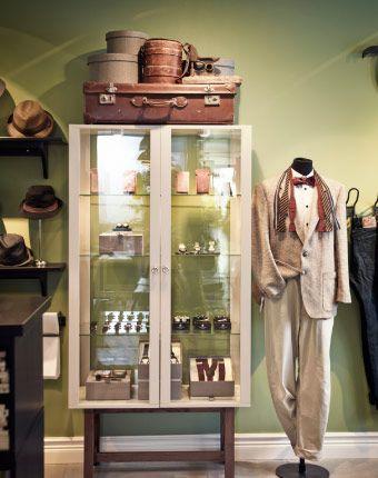 Men's watches displayed in STOCKHOLM beige glass-door cabinet