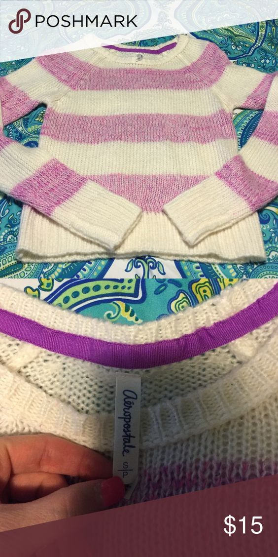 Sweater This is a striped pink, purple, and white sweater from Aeropostale. There are no signs of wear and tear. Aeropostale Sweaters Crew & Scoop Necks