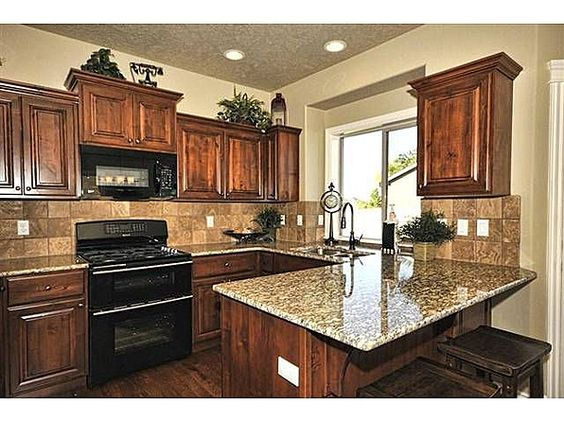 Granite countertops black appliances and granite on pinterest for Black stained cabinets