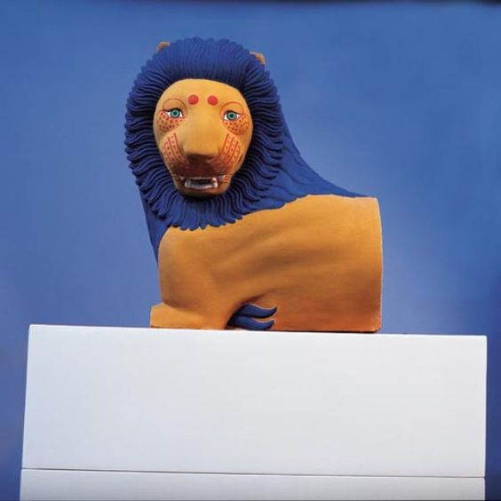 """""""If people say, 'What kitsch,' it annoys me but I'm not surprised,"""" says Brinkmann, who, with his wife, archaeologist Ulrike Koch-Brinkmann, colored this reconstruction of the c. 550 BCE """"Lion from Loutraki."""" Its stunning blue mane is not unique on ancient monuments. Lions often sat atop tombs in ancient Greece, where ornamental details such as the animals tufts of hair and facial markings were painted in bright colors that accented their fur."""