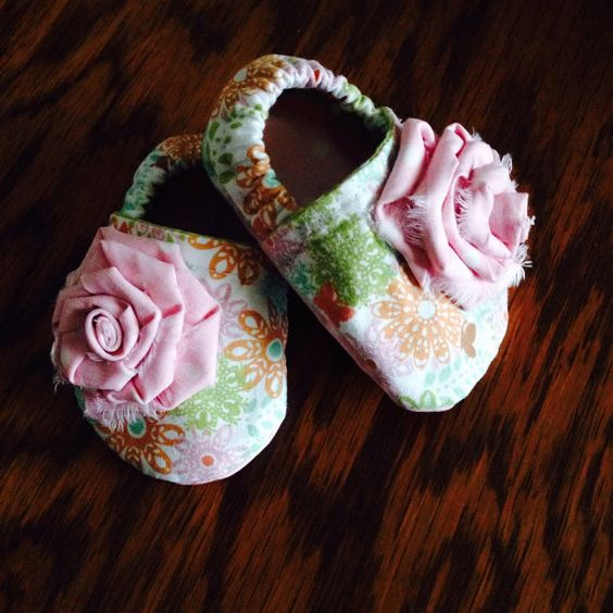 Cloth Baby Booties by Polkadotologie on Etsy I actually know the woman who made these ....... She's an amazing designer ..she's my kids cousin lol to buy or no....