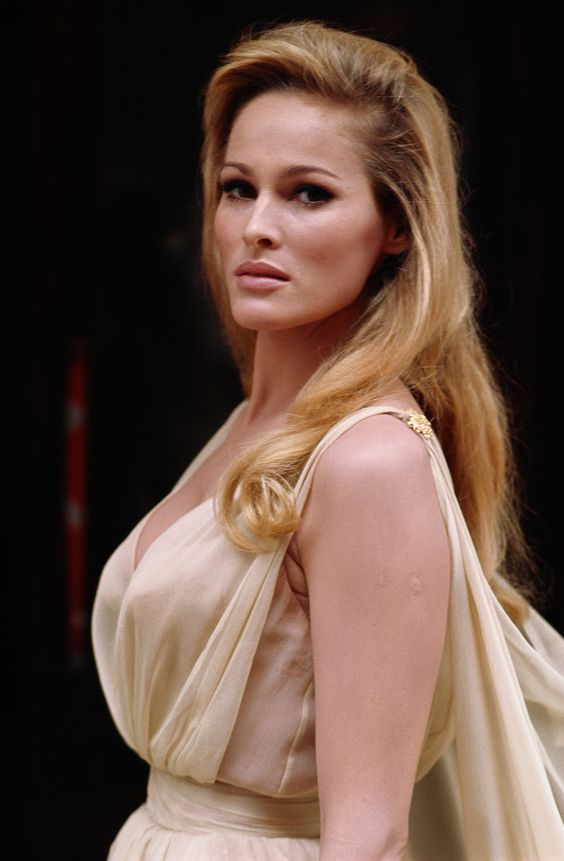 """URSULA ANDRESS (born 19 March 1936) is a Swiss-American actress and sex symbol. She is best known for her role as Bond girl Honey Rider in the first James Bond film, """"Dr. No"""", for which she won a Golden Globe."""