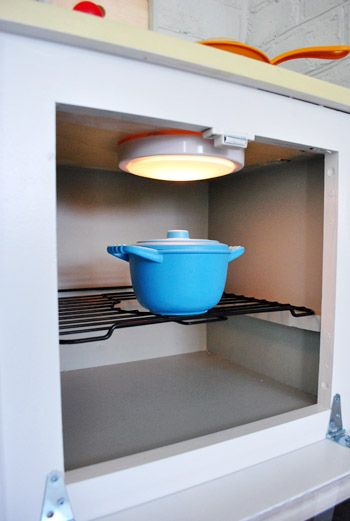 Add tap light to play kitchen oven.
