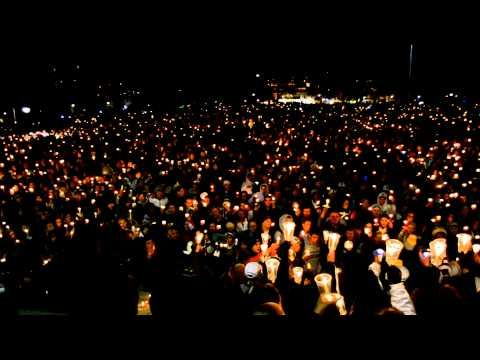 Penn State students singing the Alma Mater during the vigil for victims of child abuse.
