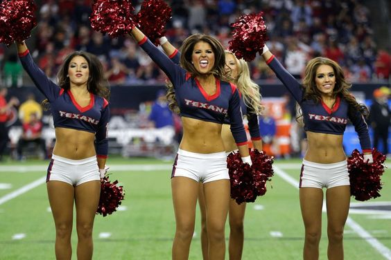 Houston Texans cheerleaders perform during a playoff game against the Kansas…