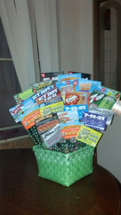 Bought the basket, green foam & green rocks from the dollar store.  Used wooden skewers wrapped in green pipe cleaners and taped the lotto tickets to the back.