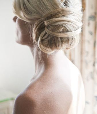 love this messy bun. looks carefree, but probably takes hours to build. pinned by danarogersphotography.com