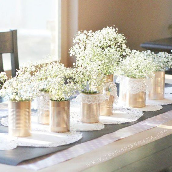 Are you wanting to achieve a slightly rustic look? Lace wedding ideas are perfect for that! Grab a tin can (or bottle or wood flower box) and wrap some lace around it! It instantly transforms the centerpiece into something sweet and delicate.