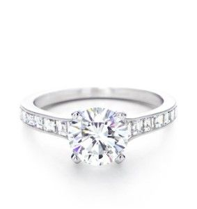 Tiffanys...want this exact ring! Round brilliant with square-cut channel-set band