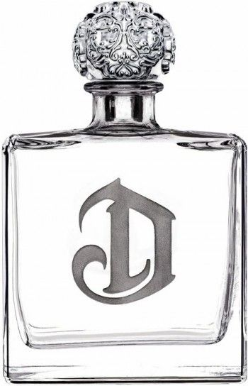 DeLeon Tequila Diamante Blanco. The sterling silver top is hand carved from a one pound sterling silver ball by jewelry designer Bill Wall.