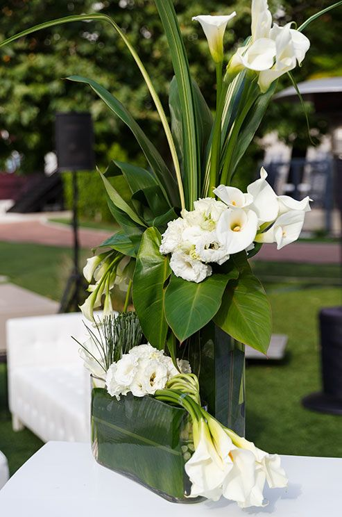 This floral arrangement of white calla lilies and