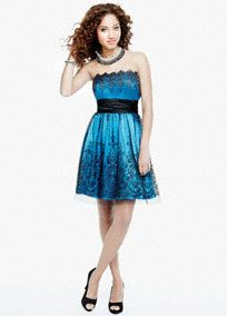 This sparkling sequin homecoming dress is a clear fashion winner!  Strapless bodice features dazzling sequin embroidered detail.  Charmeuse sash at waist helps shape a stunning silhouette.  Tulle overlay finishes off the look.  Fully lined. Side zip. Imported polyester. Spot clean.