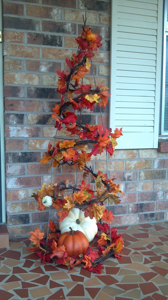 Fall tree made with a tomato cage (Halloween with spider webs and spiders)