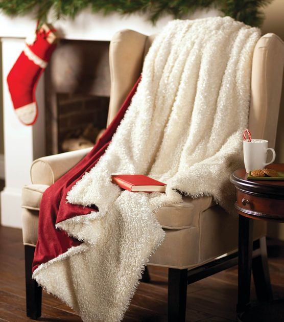Stay warm over the holidays with this Santa Fur Throw!