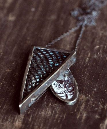 UNEARTHEN  TRIANGLE LOCKET PENDANT  $440.00