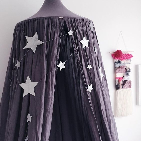 numero74 Dusty Lilac canopy adorned with a silver falling star garland: