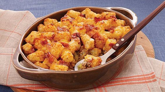 Welcome your family with tater casserole made using ground beef, potato nuggets and cheese – a hearty dinner for six.