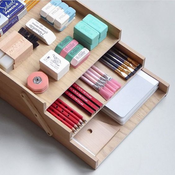 Use a layered storage box to store and divide stationery essentials                                                                                                                                                                                 More