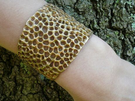 Molten Honeycomb Cuff:Cast in recycled bronze from an original wax model, this beauty radiates warmth like like golden honey on a summer day...