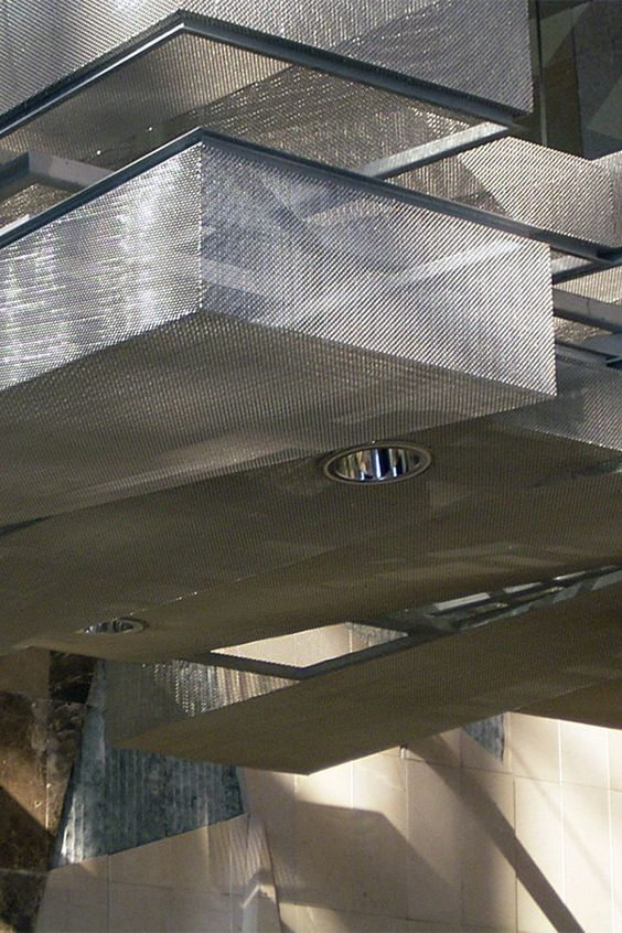 Wire mesh ceiling elements made of HAVER Architectural Mesh. Exhibition Center Málaga.