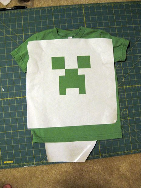 Complete 6 step DIY instructions for making a creeper shirt. Picture of Attach the stencil to the shirt