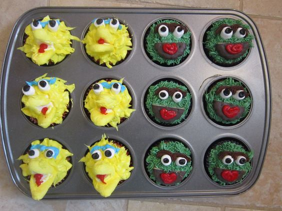 Big Bird and Oscar cupcakes  I'm so proud of myself for thinking to use a Peeps chick for Bird's beak!