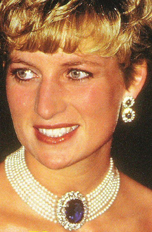 7 strand pearl choker with oval sapphire and diamond cluster (originally a brooch given her by the Queen Mother as a wedding present).  The double cluster pendant earrings she had made from the King Fahd parure watch band.  See the Leslie Field book, The Queen's Jewels.