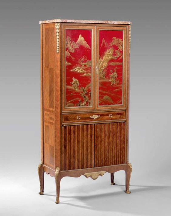 meuble en placage de bois de rose dans des encadrements d 39 amarante ouvrant deux vantaux. Black Bedroom Furniture Sets. Home Design Ideas