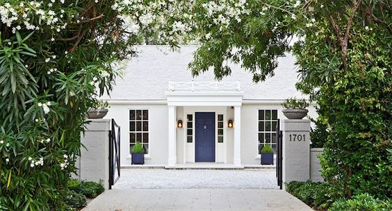 Navy Blue Front Door on the White Painted Brick Home of Gwyneth Paltrow LoveNowSellLater.com