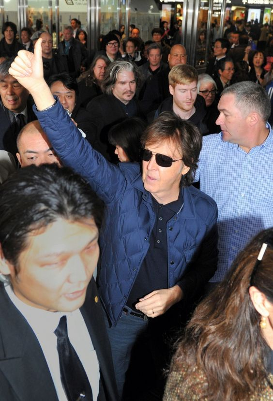 Did you hear about the upcoming Beatles GRAMMY special? It's Macca-approved. Paul McCartney offers a thumbs-up to fans at Hakata Station in Fukuokoa, Japan on Nov. 14